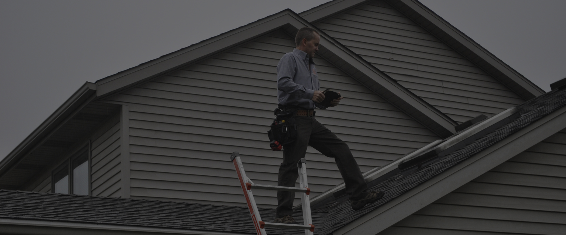 Scott inspecting roof