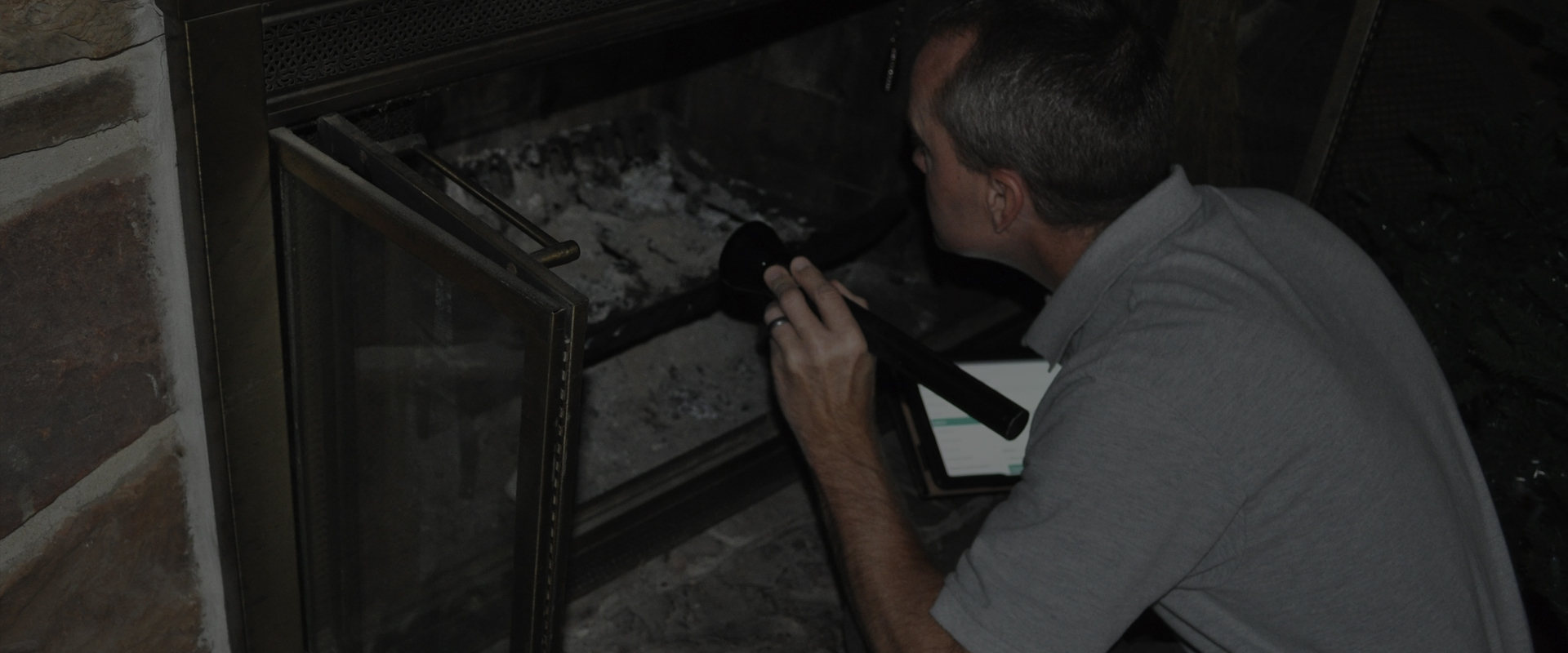Scott inspecting fireplace